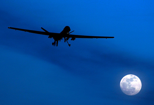 APTOPIX_Afghanistan_Drone_L.JPG A U.S. Predator drone flies over the moon above Kandahar Air Field, southern Afghanistan Sunday, Jan. 31, 2010. The Pakistani army said Sunday that it was investigating reports that Pakistani Taliban leader Hakimullah Mehsud died from injuries sustained in a U.S. drone missile strike in mid-January. (AP Photo/Kirsty Wigglesworth)