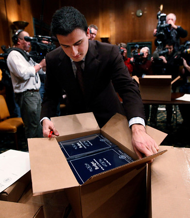 APTOPIX_Budget_DCMC106.JPG Senate staff member Sam Armocido unpacks copies of President Barack Obama's budget which was delivered to the Senate Budget Committee, Monday, Feb. 1, 2010, on Capitol  Hill in Washington.  (AP Photo/Manuel Balce Ceneta)