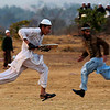 APTOPIX_PAKISTAN_DAILY_LIFE.JPG Tow Pakistanis run while playing cricket in a field on the outskirts of Islamabad, Pakistan, Monday, Feb. 1, 2010. (AP Photo/Muhammed Muheisen)
