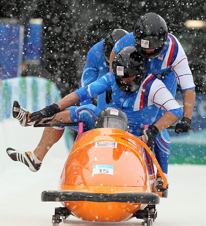 The Czech Republic's CZE-1, Jan Kobian, stumbles at the start and struggles to get into the sled with teammates Ivo Danilevic, front, Dominik Suchy, and Jan Stoklaska, during the men's four-man bobsled competition at the Vancouver 2010 Olympics in Whistler, British Columbia, Friday, Feb. 26, 2010. (AP Photo/Ricardo Mazalan)