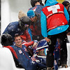 The United States' USA-2, with John Napier, getting out of sled, and teammates Charles Berkeley, Steven Langton, and Christopher Fogt, crash during the men's four-man bobsled competition at the Vancouver 2010 Olympics in Whistler, British Columbia, Friday, Feb. 26, 2010. (AP Photo/Michael Sohn)