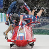 United States' USA-3, Jamie Moriarty stumbles at the start and has to be pulled into the sled with teammates Mike Kohn, front, Bill Schuffenhauer, left, and Nick Cunningham, during the men's four-man bobsled competition at the Vancouver 2010 Olympics in Whistler, British Columbia, Friday, Feb. 26, 2010. (AP Photo/Ricardo Mazalan)