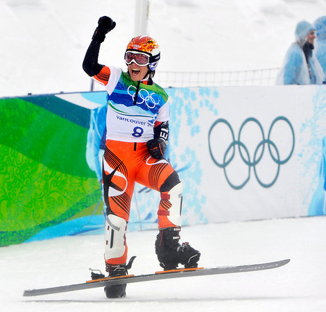 Nicolien Sauerbreij, of Holland, reacts to winning her semifinal on her way to become Olympic champion in the women's Parallel Giant Slalom snowboarding competition at the Vancouver 2010 Olympics in Vancouver, British Columbia, Friday, Feb. 26, 2010. (AP Photo/Bela Szandelszky)