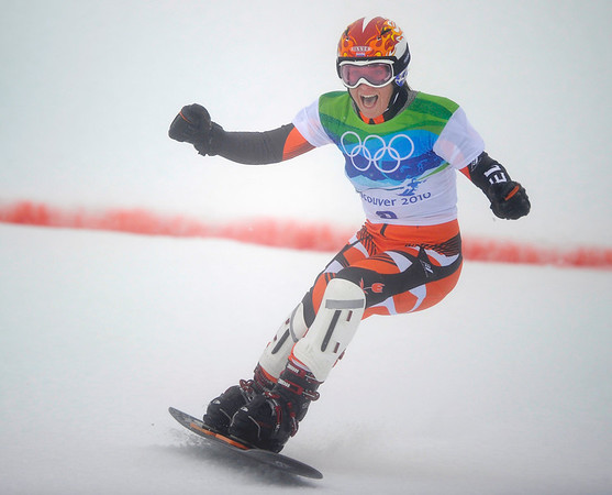 Nicolien Sauerbreij of Holland reacts as she crosses the finish line to win Olympic title in the women's Paralell Giant Slalom snowboarding competition at the Vancouver 2010 Olympics in Vancouver, British Columbia, Friday, Feb. 26, 2010. (AP Photo/Mark J. Terrill)