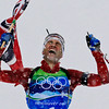 Norway's Ole Einar Bjoerndalen celebrates as he crosses the finish line to give Norway the gold medal in the men's biathlon  relay at the Vancouver 2010 Olympics in Whistler, British Columbia, Friday, Feb. 26, 2010.(AP Photo/Anja Niedringhaus)