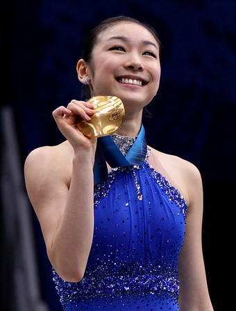 South Korea's Kim Yu-Na poses on the podium after winning the gold medal in the women's figure skating competition at the Vancouver 2010 Olympics in Vancouver, British Columbia, Thursday, Feb. 25, 2010. (AP Photo/Mark Baker)