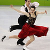 Canada's Tessa Virtue and Scott Moir perform their original dance during the ice dance figure skating competitionat the Vancouver 2010 Olympics in Vancouver, British Columbia, Sunday, Feb. 21, 2010. (AP Photo/Mark Baker)
