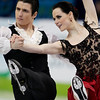 Canada's Tessa Virtue and Scott Moir perform their original dance during the ice dance figure skating competition at the Vancouver 2010 Olympics in Vancouver, British Columbia, Sunday, Feb. 21, 2010. (AP Photo/Ivan Sekretarev)
