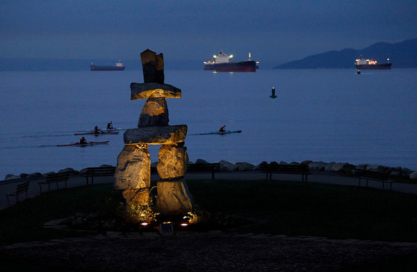 An Inukshuk monument is seen during first light in English Bay in Vancouver, British Columbia, Tuesday, Feb. 9, 2010.  An Inukshuk design is the basis of the logo of the Vancouver 2010 Olympic Games which begin Feb. 12.  Friendship and the welcoming of the world are the meanings of both the English Bay structure and the 2010 Winter Olympics emblem.  (AP Photo/Matt Dunham)