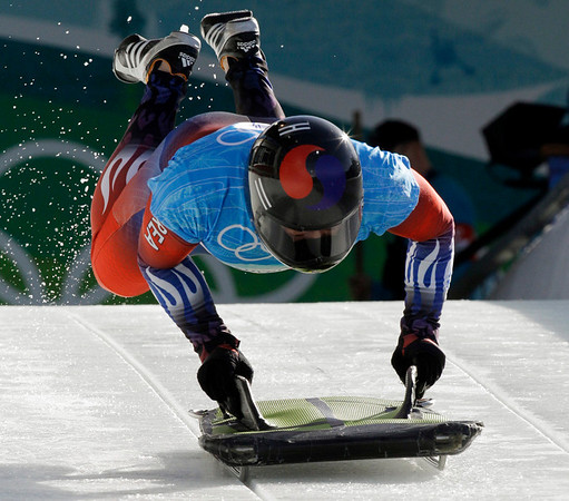 In Ho Cho of Korea starts during men's skeleton training at the Vancouver 2010 Olympics in Whistler, British Columbia, Wednesday, Feb. 17, 2010. (AP Photo/Michael Sohn)