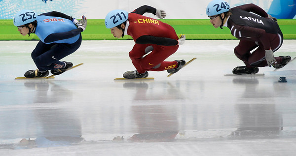 USA's J.R. Celski leads China's Xianwei Liu, center, and Latvia's Haralds Silovs, right, during the third heat of the men's 1500m semifinals short track skating competition at the Vancouver 2010 Olympics in Vancouver, British Columbia, Saturday, Feb. 13, 2010. (AP Photo/Ivan Sekretarev)