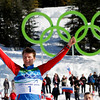Russia's Alexander Panzhinskiy  celebrates winning the silver medal during flower ceremony of the Men's individual classic sprint Cross Country final at the Vancouver 2010 Olympics in Whistler, British Columbia, Canada, Wednesday, Feb. 17, 2010. (AP Photo/Matthias Schrader)