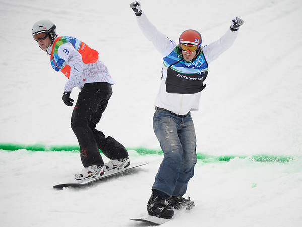 Seth Wescott of the USA, right beats Mike Robertson of Canada, left to win the snowboard cross at the Vancouver 2010 Olympics in Vancouver, British Columbia, Monday, Feb. 15, 2010. (AP Photo/Mark J. Terrill)