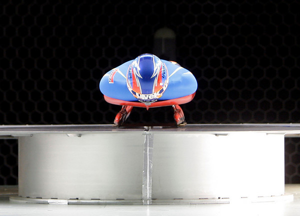 United States Olympic luge team member Mark Grimmette is positioned for a wind tunnel test on a new racing suit to be used for the upcoming Vancouver Winter Olympics at the San Diego Air and Space Museum on Wednesday, Feb. 3, 2010, in San Diego. (AP Photo/Lenny Ignelzi)