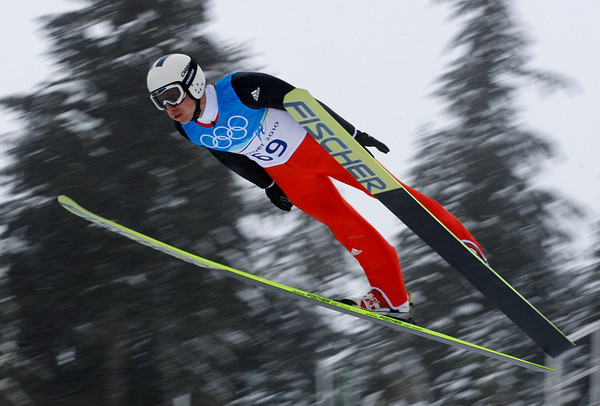 Switzerland's Simon Ammann makes an attempt during a ski jumping training session at the Vancouver 2010 Olympics in Whistler, British Columbia, Canada, Thursday, Feb. 11, 2010. (AP Photo/Dmitry Lovetsky)
