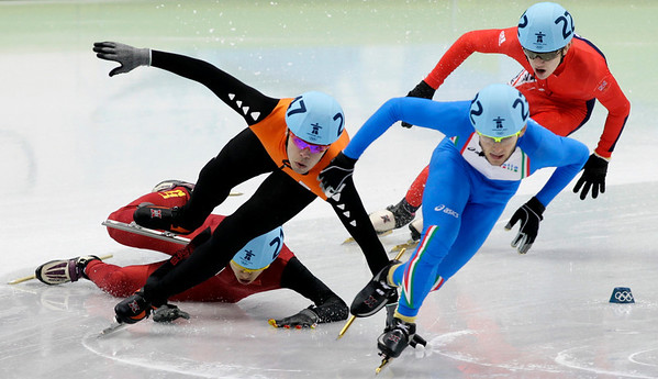 China's Weilong Song, back left, crashes out during the fourth heat of the men's 1500m short track skating competition for the Vancouver 2010 Olympics in Vancouver, British Columbia, Saturday, Feb. 13, 2010. (AP Photo/Ivan Sekretarev)