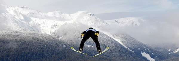Japan's Noriaki Kasai makes an attempt during the ski jumping normal hill qualification at the Vancouver 2010 Olympics in Whistler, British Columbia, Canada, Friday, Feb. 12, 2010. (AP Photo/Matthias Schrader)