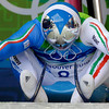 The track is reflected on the helmet of Armin Zoeggeler of Italy as he gets ready to start the third run of the men's singles luge event, at the Vancouver 2010 Olympics in Whistler, British Columbia, Sunday, Feb. 14, 2010. (AP Photo/Charlie Krupa)