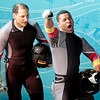 Germany's GER-2, piloted by Thomas Florschuetz, left, and brakeman Richard Adjei, celebrate in the finish area during the men's two-man bobsled final competition at the Vancouver 2010 Olympics in Whistler, British Columbia, Sunday, Feb. 21, 2010. GER-2 won the silver medal. (AP Photo/Elise Amendola)