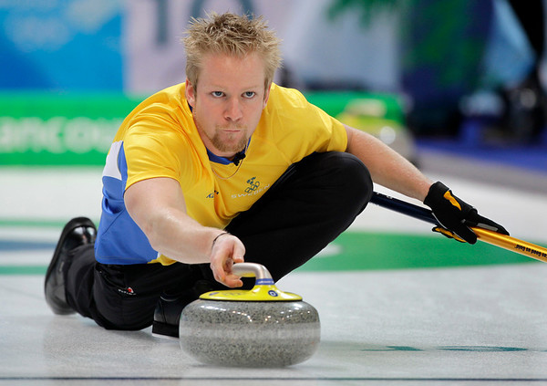 Sweden's Niklas Edin delivers a stone in a match against Germany during round robin session 2 of men's curling at the Vancouver 2010 Olympics in Vancouver, British Columbia, Wednesday, Feb. 17, 2010. (AP Photo/Robert F. Bukaty)