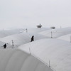 Workers make their way on top of BC Place Stadium in Vancouver, British Columbia, Wednesday, Feb. 3, 2010. The opening ceremony of the Vancouver 2010 Olympics will take place at the stadium. (AP Photo/Jae C. Hong)