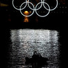 A security boat floats past the Olympic rings in the Vancouver harbor near the press center for the Winter Olympics on Tuesday, Feb. 9, 2010, in Vancouver, British Columbia, Canada. (AP Photo/The Canadian Press, Adrian Wyld)