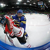 Sweden's defenseman Emma Eliasson (22) checks Canada's forward Rebecca Johnston (6) in the third period in women's preliminary round hockey play at the Vancouver 2010 Olympics in Vancouver, British Columbia, Wednesday, Feb. 17, 2010. (AP Photo/Gene J. Puskar)