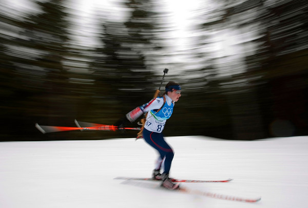 U.S. Biathlete Laura Spector during a training session at the Biathlon track at the Vancouver 2010 Olympics in Whistler, British Columbia, Friday, Feb. 12, 2010. (AP Photo/Andrew Medichini)