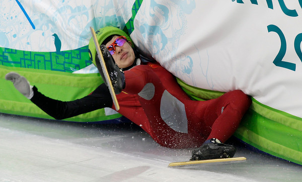 China's Nannan Zhao crashes out during the eighth heat of the women's 500m short track skating competition at the Vancouver 2010 Olympics in Vancouver, British Columbia, Saturday, Feb. 13, 2010. (AP Photo/Ivan Sekretarev)