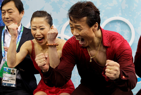 China's Shen Xue and Zhao Hongbo react after receiving the highest score, to win gold, for performing their pairs free program during the figure skating competition at the Vancouver 2010 Olympics in Vancouver, British Columbia, Monday, Feb. 15, 2010. (AP Photo/Amy Sancetta)
