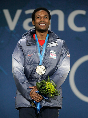 USA silver medal winner Shani Davis celebrates during the medal ceremony for the men's speed skating 1500m race at the Vancouver 2010 Olympics in Vancouver, British Columbia, Sunday, Feb. 21, 2010. (AP Photo/Jae C. Hong)