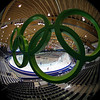 The Olympic rings are seen at the Richmond Olympic Oval as speed skaters practice at the Vancouver 2010 Olympics in Vancouver, British Columbia, Wednesday, Feb. 10, 2010. (AP Photo/Matt Dunham)
