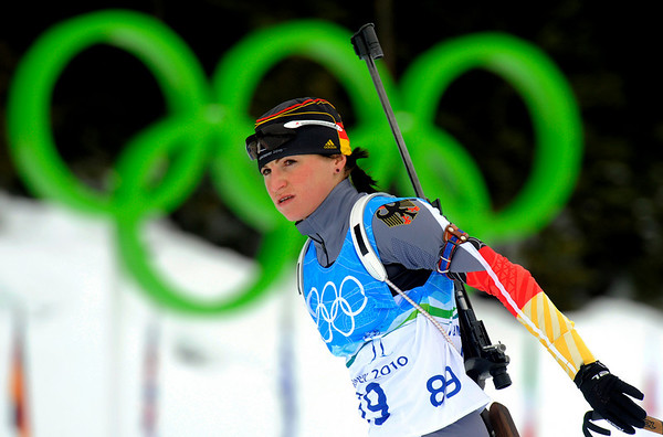 German Biathlete Andrea Henkel during a training session at the Biathlon track at the Vancouver 2010 Olympics in Whistler, British Columbia, Friday, Feb. 12, 2010. (AP Photo/Jens Meyer)