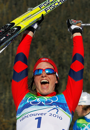 Norway's Marit Bjoergen celebrates winning the gold medal  after the Women's individual classic sprint Cross Country final at the Vancouver 2010 Olympics in Whistler, British Columbia, Canada, Wednesday, Feb. 17, 2010. (AP Photo/Matthias Schrader)