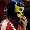 A fan of Sweden's men's ice hockey team watches the first period of a preliminary round game against Germany at the Vancouver 2010 Olympics in Vancouver, British Columbia, Wednesday, Feb. 17, 2010. (AP Photo/Julie Jacobson)