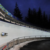 Tall evergreen trees line a turn during the men's luge training runs at the Whistler Sliding Center, Wednesday, Feb. 10, 2010, at the 2010 Vancouver Olympic Winter Games in Whistler, British Columbia. (AP Photo/The Canadian Press, Mathew McCarthy)