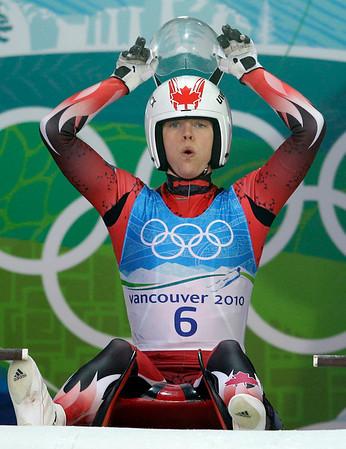 Regan Lauscher of Canada prepares to start a practice run during a women's singles luge training run at the Vancouver 2010 Olympics in Whistler, British Columbia, Thursday, Feb. 11, 2010. (AP Photo/Ricardo Mazalan)