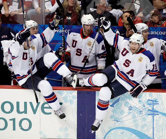 USA's Ryan Whitney (19) and Jack Johnson (3) react after a preliminary round men's ice hockey game against Canada at the Vancouver 2010 Olympics in Vancouver, British Columbia, Sunday, Feb. 21, 2010. USA won 5-3. (AP Photo/Matt Slocum)
