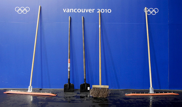 Squeegees and other equipment are seen prior to a training session at the Pacific Coliseum venue, where the figure skating and short track speed skating will be held, at the Vancouver 2010 Olympics in Vancouver, British Columbia, Wednesday, Feb. 10, 2010. (AP Photo/Amy Sancetta)