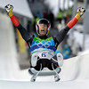 APTOPIX_Vancouver_Olymp(15).JPG David Moeller of Germany celebrates his silver medal finish during the final run of the men's singles luge competition at the Vancouver 2010 Olympics in Whistler, British Columbia, Sunday, Feb. 14, 2010. (AP Photo/Michael Sohn)