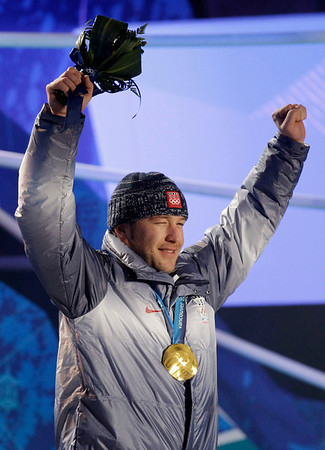 United States' gold medal winner Bode Miller celebrates during the medal ceremony for the Men's Alpine Skiing super-combined at the Vancouver 2010 Olympics in Whistler, British Columbia, Canada, Sunday, Feb. 21, 2010. (AP Photo/Lee Jin-man)