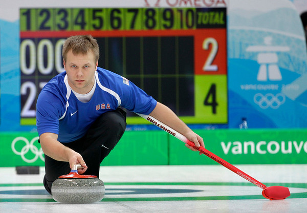 American Jeff Isaacson delivers a stone in a match against Switzerland during round robin session 2 of men's curling at the Vancouver 2010 Olympics in Vancouver, British Columbia, Wednesday, Feb. 17, 2010. (AP Photo/Robert F. Bukaty)