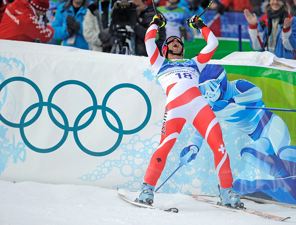 Switzerland's Didier Defago reacts after completing the Men's downhill at the Vancouver 2010 Olympics in Whistler, British Columbia, Monday, Feb. 15, 2010.  (AP Photo/Gero Breloer)