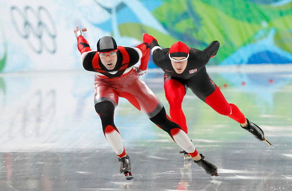 Canada's Francois-Olivier Roberge, left, and Norway's Mikael Flygind Larsen, right, compete during the men's 1,000 meter speed skating race at the Richmond Olympic Oval at the Vancouver 2010 Olympics in Vancouver, British Columbia, Wednesday, Feb. 17, 2010. (AP Photo/Chris Carlson)