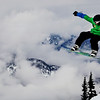 A snowboarder flies through the air as he goes down Mount Blackcomb in Whistler, British Columbia, Monday, Feb. 8, 2010. Whistler will host several events of the upcoming Vancouver 2010 Olympics. (AP Photo/Anja Niedringhaus)