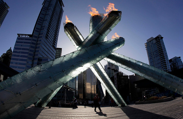 The Olympic flame is seen at the Vancouver 2010 Olympics in Vancouver, British Columbia, Sunday, Feb. 14, 2010. (AP Photo/Marcio Sanchez)
