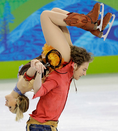 France's Nathalie Pechalat and Fabian Bourzat perform their original dance during the ice dance figure skating competition at the Vancouver 2010 Olympics in Vancouver, British Columbia, Sunday, Feb. 21, 2010. (AP Photo/David J. Phillip)