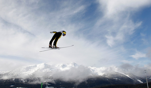 Norway's Tom Hilde makes an attempt during the ski jumping normal hill qualification at the Vancouver 2010 Olympics in Whistler, British Columbia, Canada, Friday, Feb. 12, 2010. (AP Photo/Matthias Schrader)