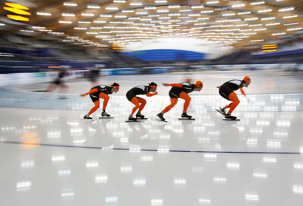 Dutch speed skaters Stefan Groothuis, Jan Smeekens, Mark Tuitert and Simon Kuipers, left to right, train at the Richmond Olympic Oval at the Vancouver 2010 Olympics in Vancouver, British Columbia, Thursday, Feb. 11, 2010.(AP Photo/Kevin Frayer)