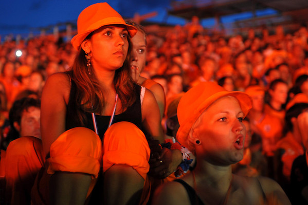 Fans of the Dutch soccer team watch the World Cup soccer final match between Netherlands and Spain in Amsterdam, Netherlands, Sunday, July 11, 2010.  Spain defeated the Dutch with a 1-0 score in extra time. (AP Photo/Ermindo Armino)